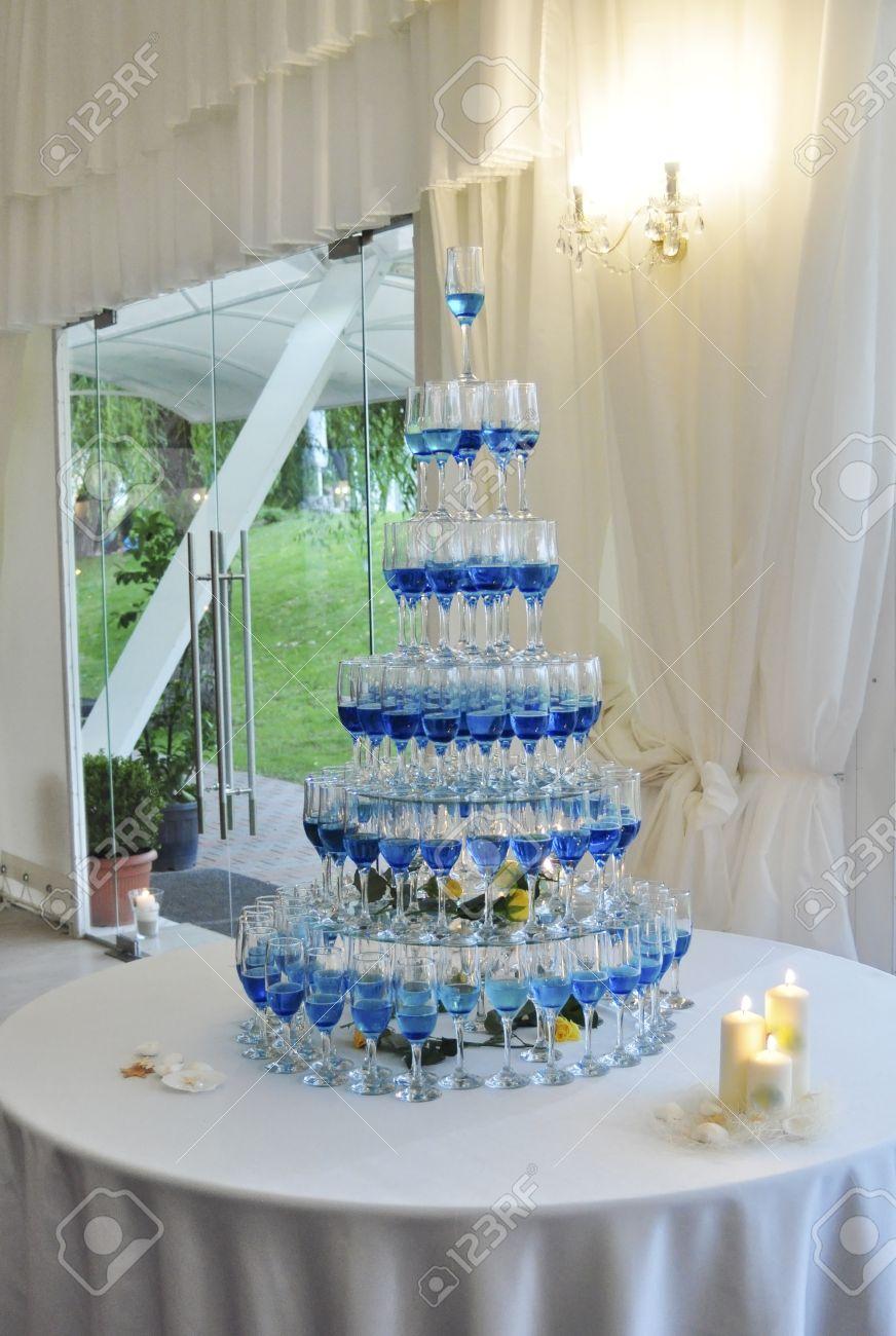 blue champagne glasses pyramid wedding table arrangement stock photo