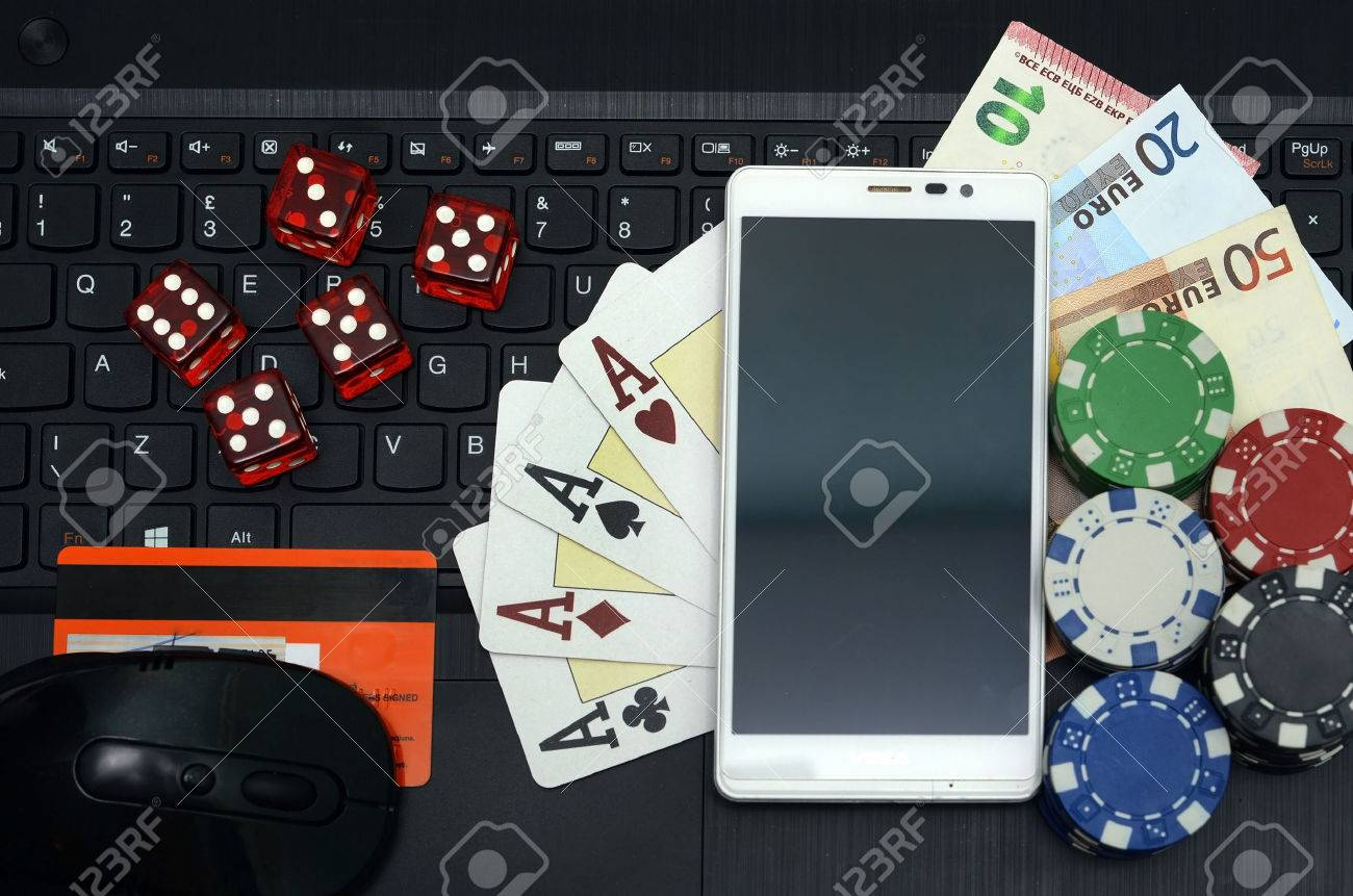 online casino games concept computer and smart phone - 44154121