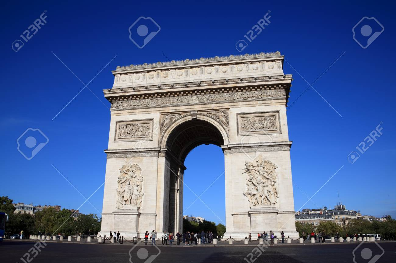Paris, France, Sep 18, 2011: The  Arc De Triomphe at the western end of the Champs-Elysees, being viewed by visiting tourists Stock Photo - 10820786
