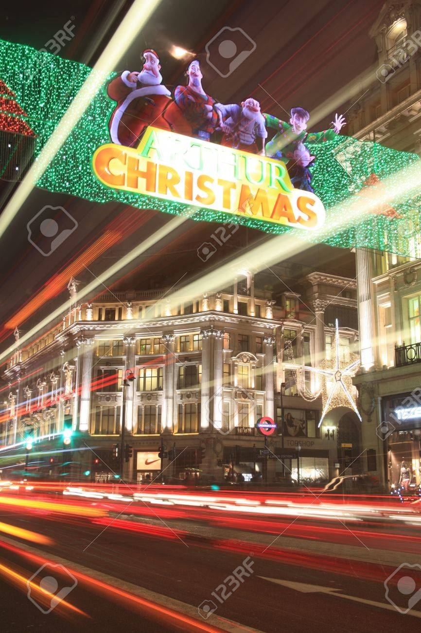 London, UK - November 12, 2011: Christmas lights at Oxford Circus at night, showing some of the displays from Regent Street and Oxford Street during the festive season, with blurred light trails from passing vehicles. Stock Photo - 11215285