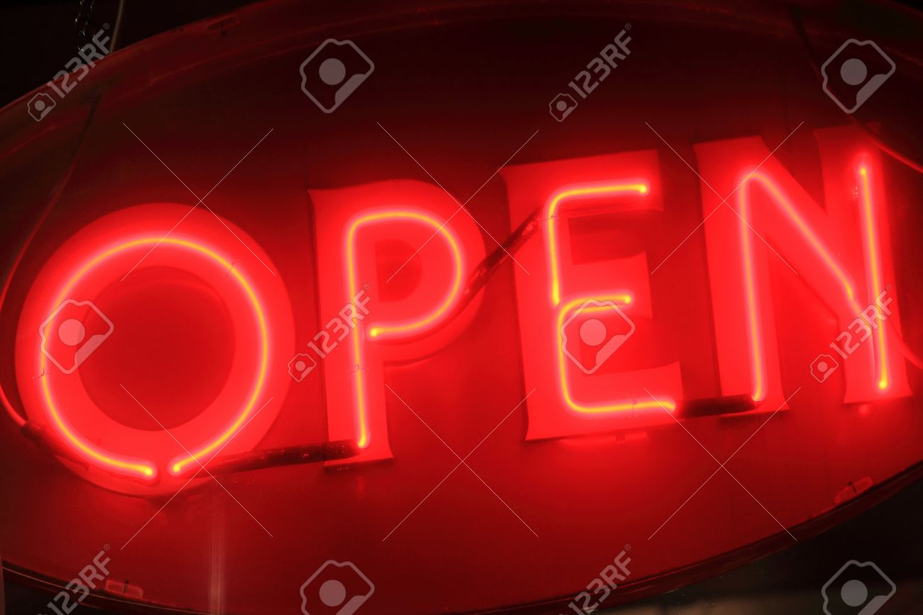 Red open neon sign sign at night Stock Photo - 11426183