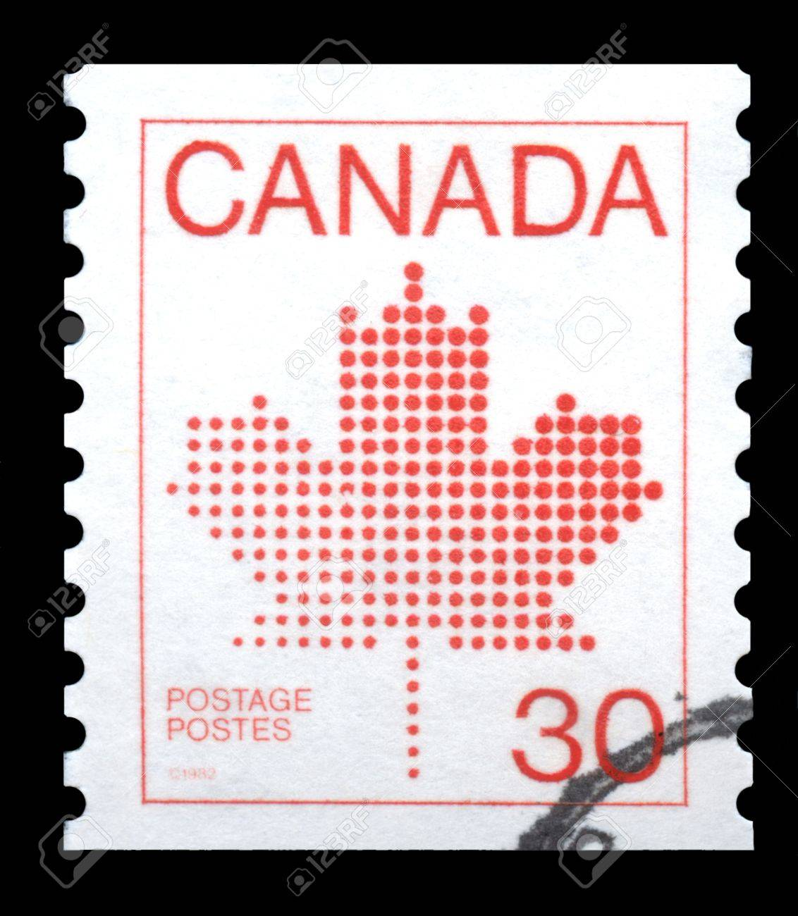 Canada postage stamp showing the red maple leaf, the symbol of Canada Stock Photo - 12361328
