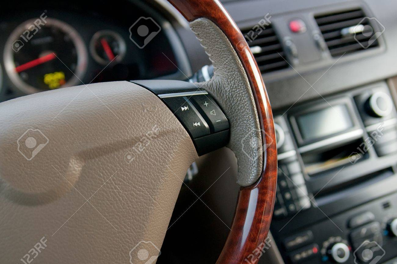 Luxury Car Interior With Wooden Steering Wheel Close Up Stock Photo