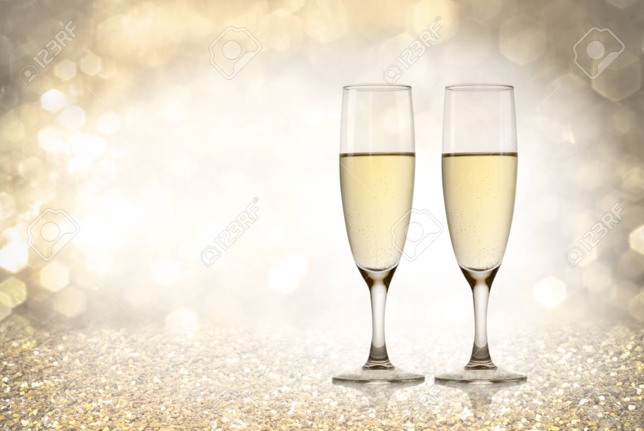 a champagne toast happy new year golden background stock photo