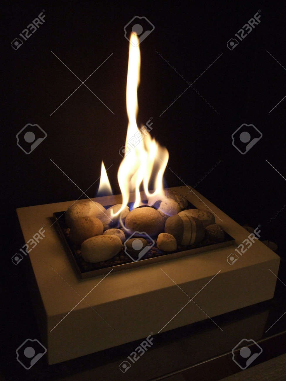 warm gas fire in a homly fireplace - 2373792