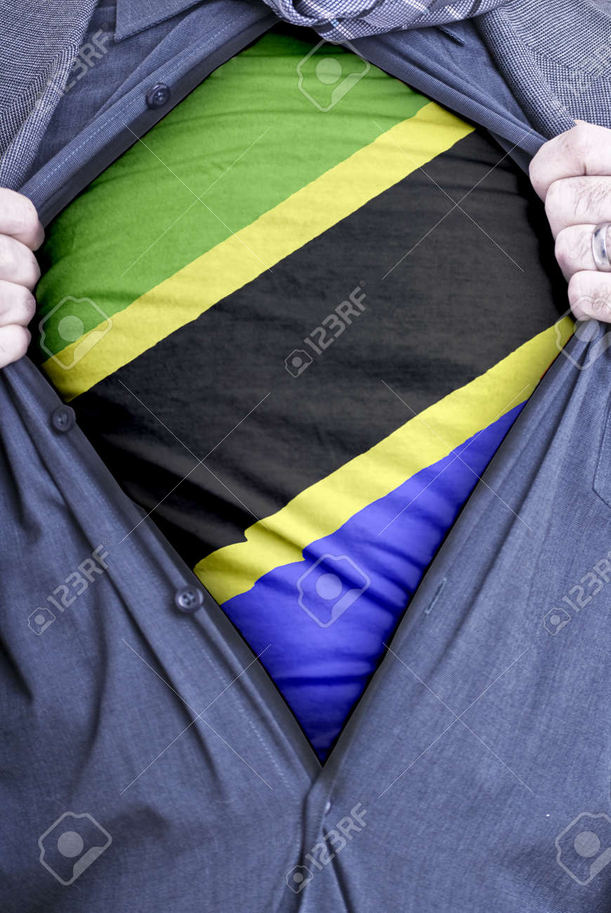 A Tanzanian businessman rips open his shirt and shows how patriotic he is by revealing his countries flag beneath printed on a t-shirt Stock Photo - 12991099