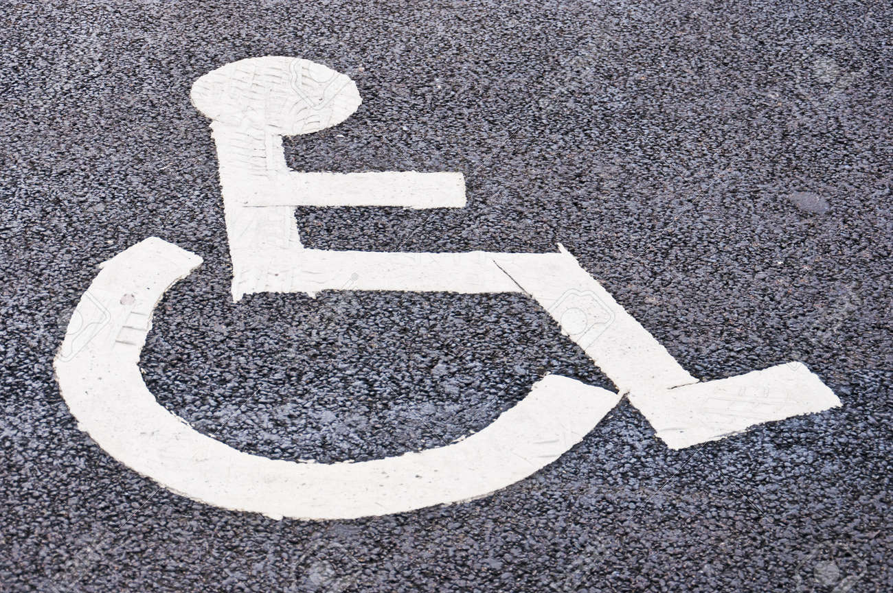A designated parking spot found in all of the worlds cities that's restricted to all but disabled drivers that have a disability of some sort. Stock Photo - 13838338