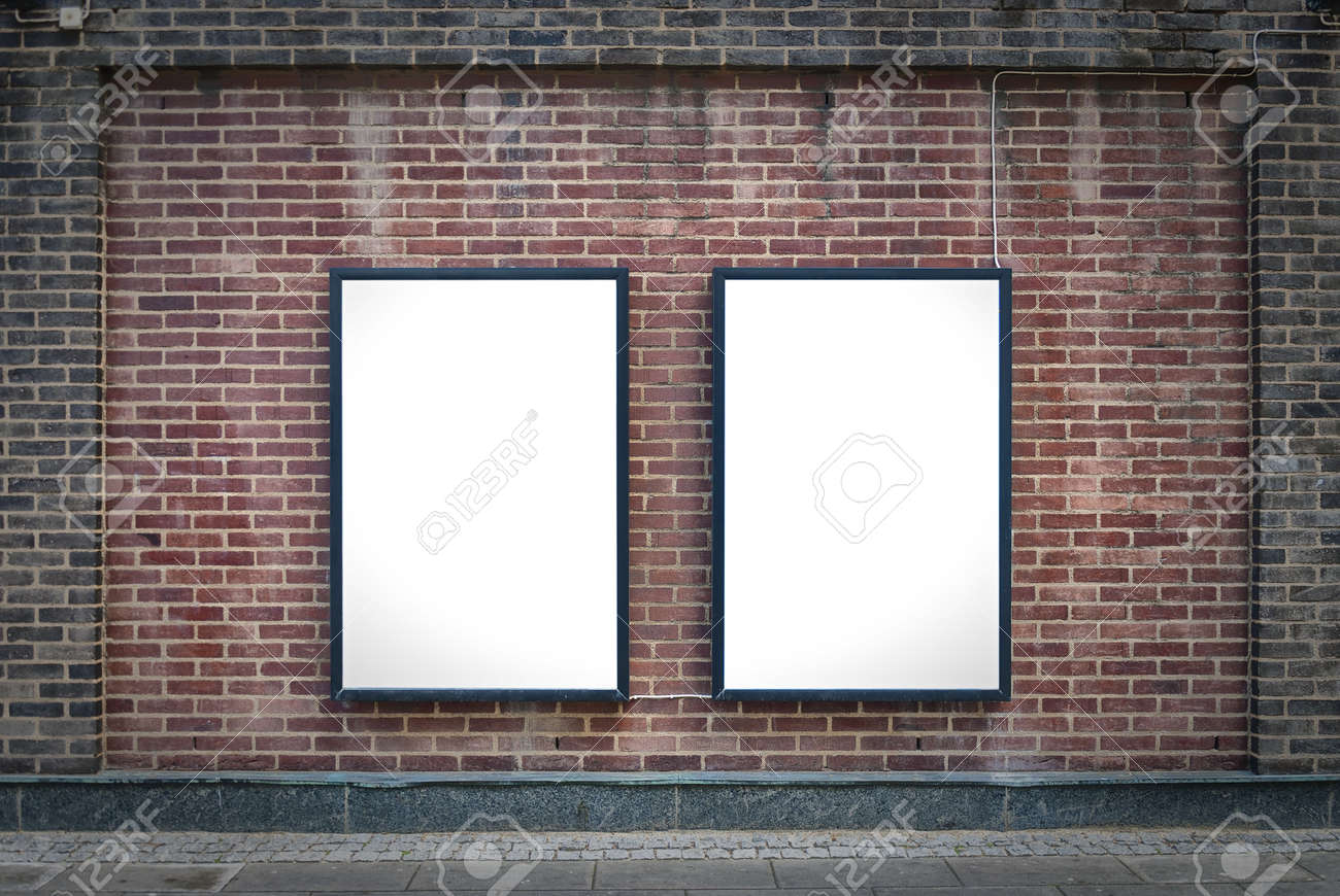 Two blank billboards attached to a buildings exterior brick wall. Stock Photo - 14584709