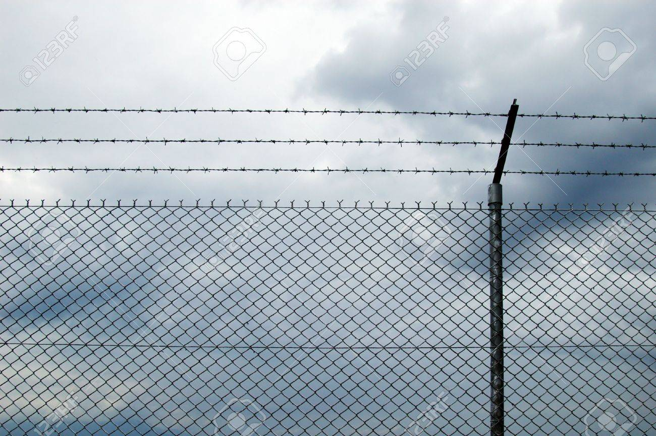 cyclone wire fence stock photo