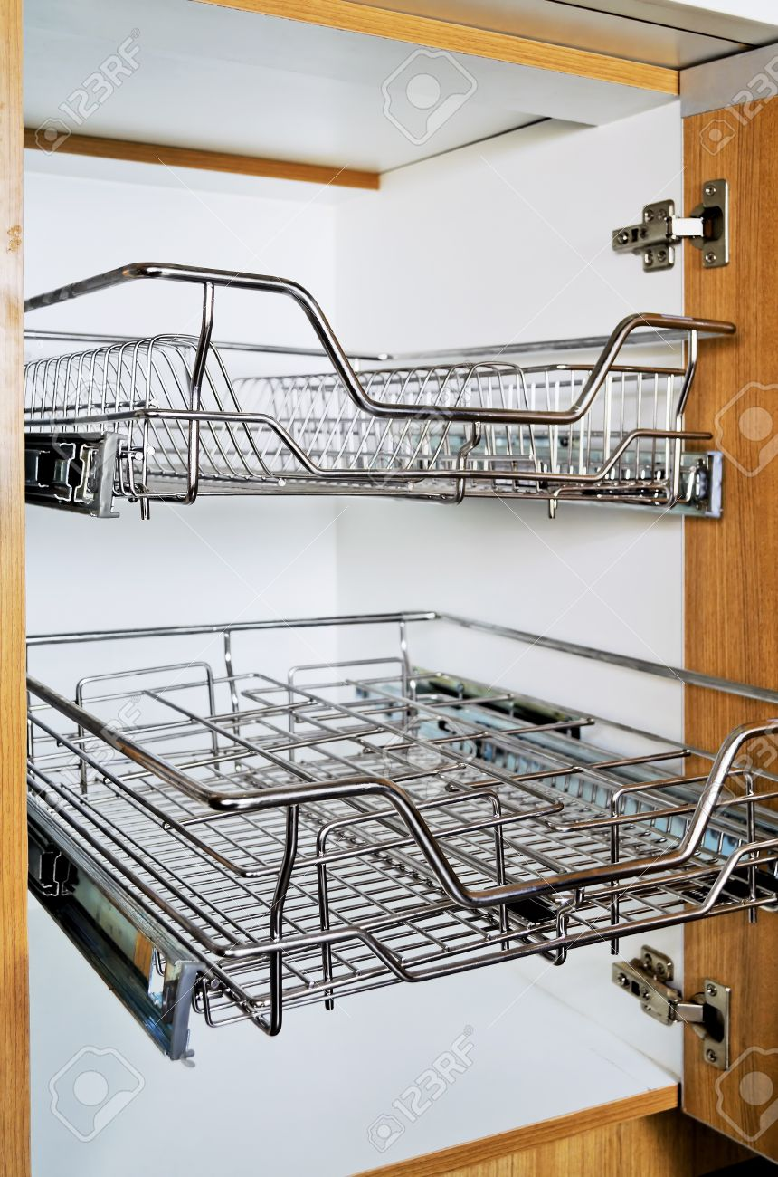 Open Kitchen Cabinet With Two Layers Of Stainless Dish Rack Stock ...
