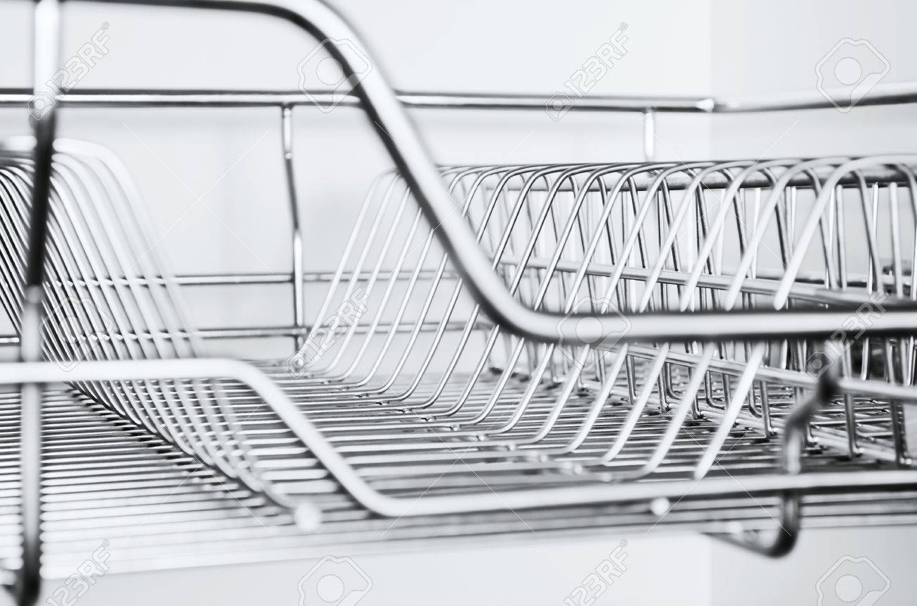 Close Up Of Stainless Steel Dish Rack Inside Kitchen Cabinet Stock Photo Picture And Royalty Free Image Image 15332297