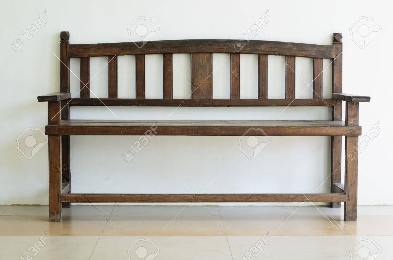 Fabulous Old Wooden Bench Shot Against Plain Wall Gmtry Best Dining Table And Chair Ideas Images Gmtryco