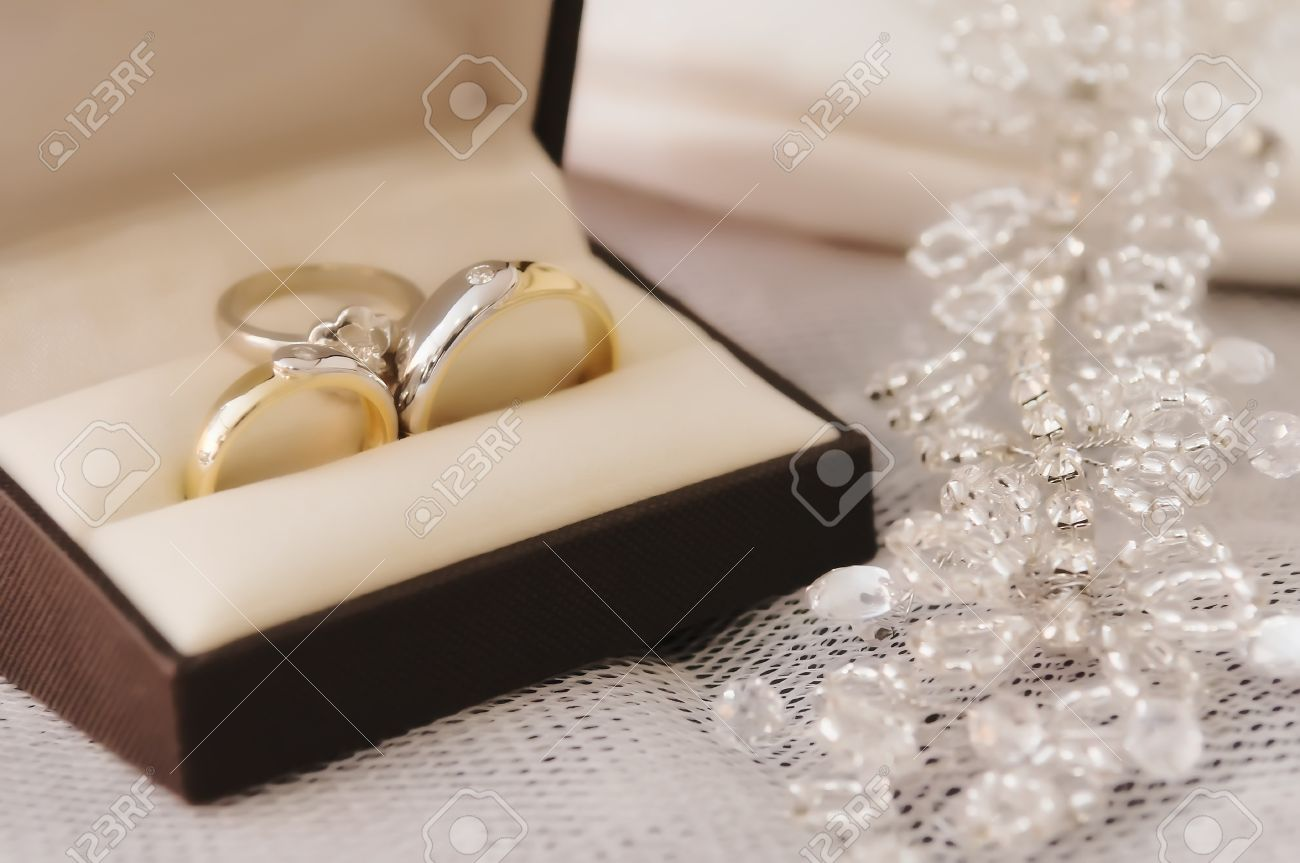 Gold Wedding Rings With Engagement Ring Inside Box Stock Photo Picture And Royalty Free Image Image 20662598