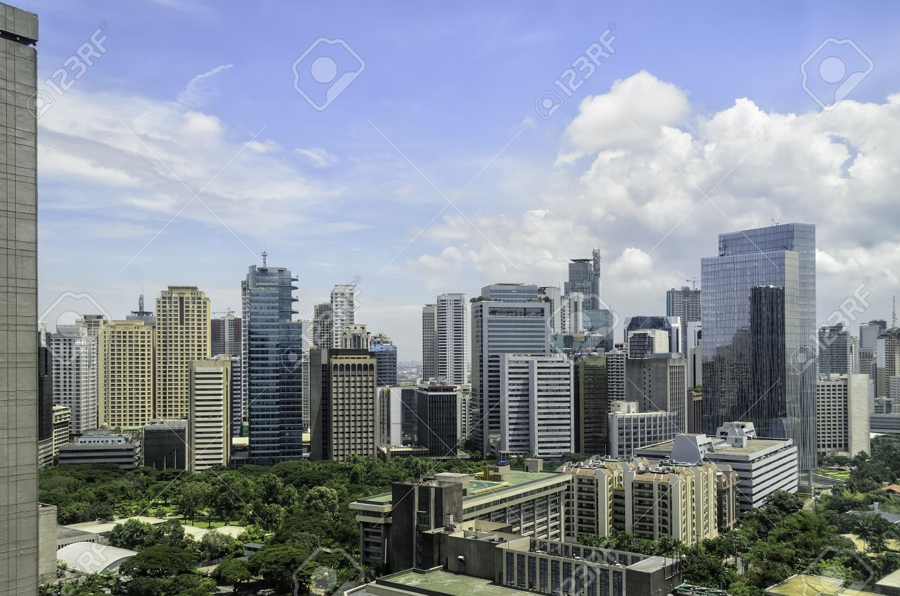 mix of old and modern urban buildings in makati city manila