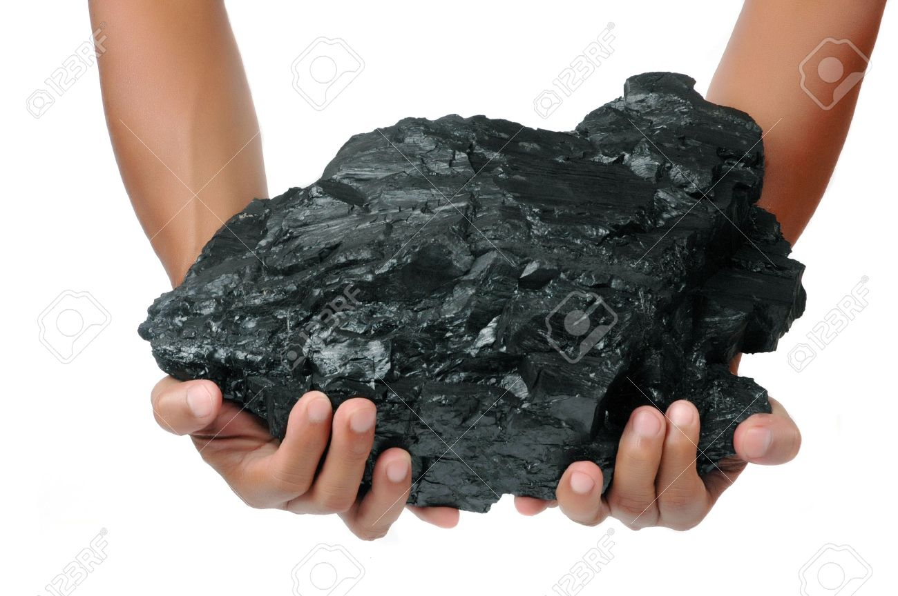 a big lump of coal is held with two hands isolated on white background Stock Photo - 10352311
