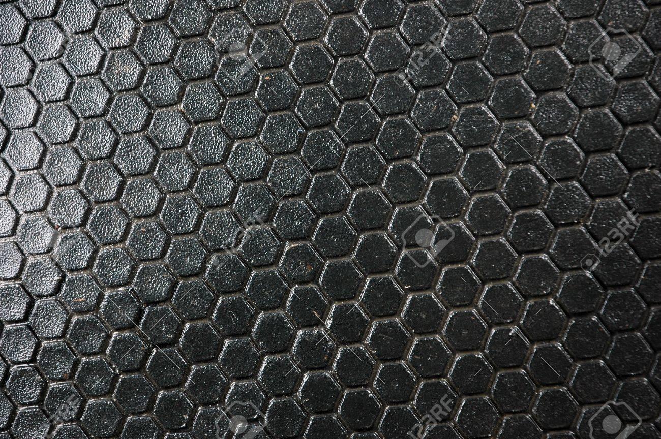 honeycomb pattern on the black rubber mats Stock Photo - 11817901