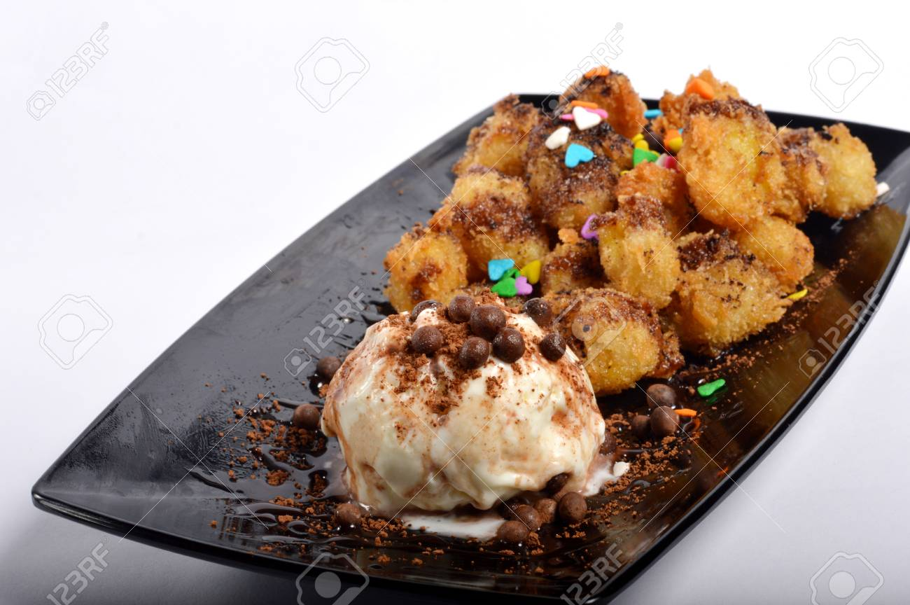 Banana Fritters With Ice Cream On White Background Stock Photo Picture And Royalty Free Image Image 52124460