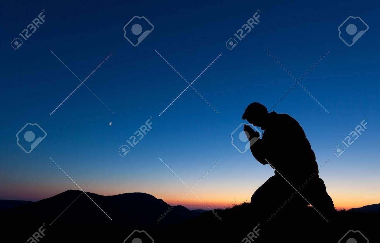 Man Kneeling And Praying | Images Guru