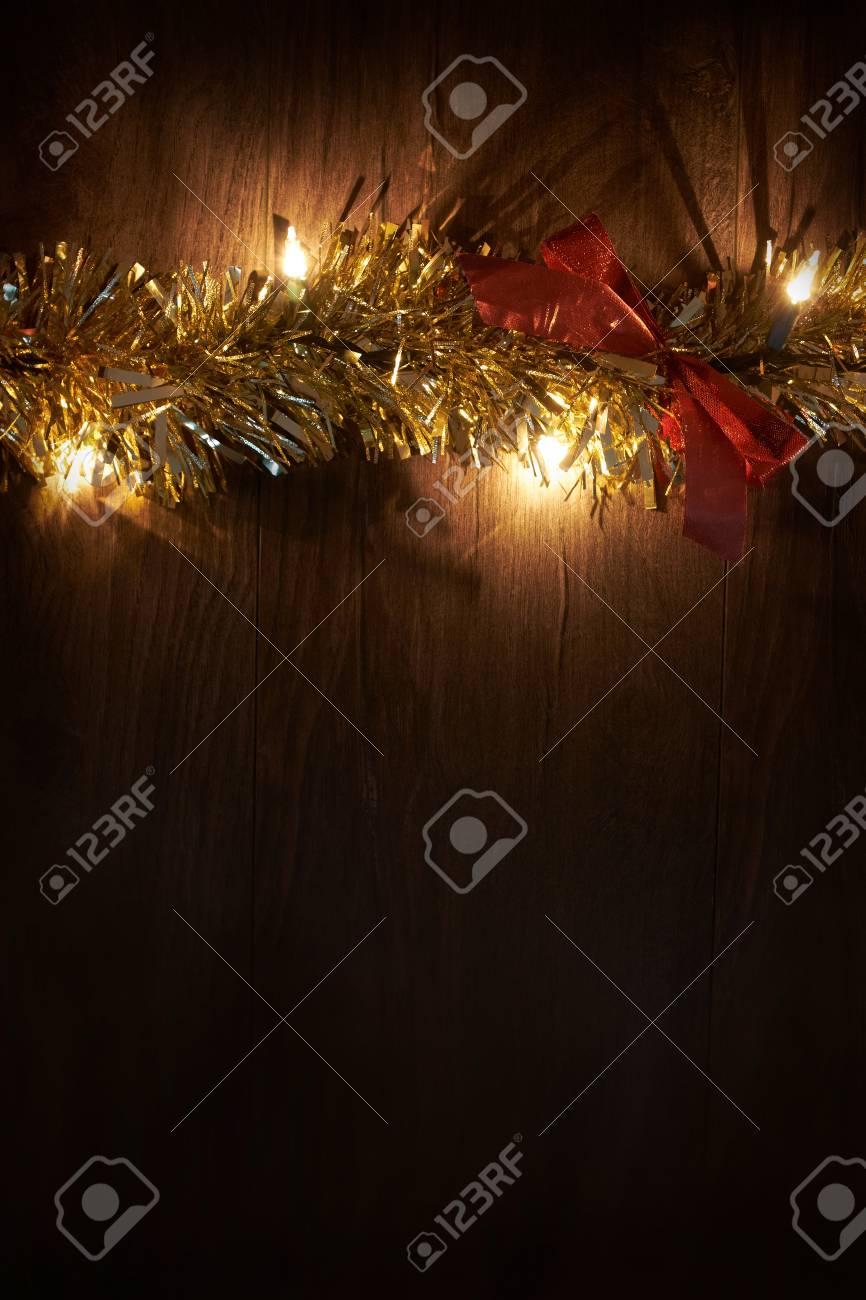 Traditional Christmas Lights.Traditional Christmas Tree Lights Tinsel And Ribbon Lying On