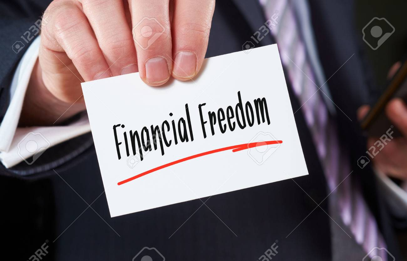 A Man Holding A Business Card Financial Freedom Concept Stock Photo ...