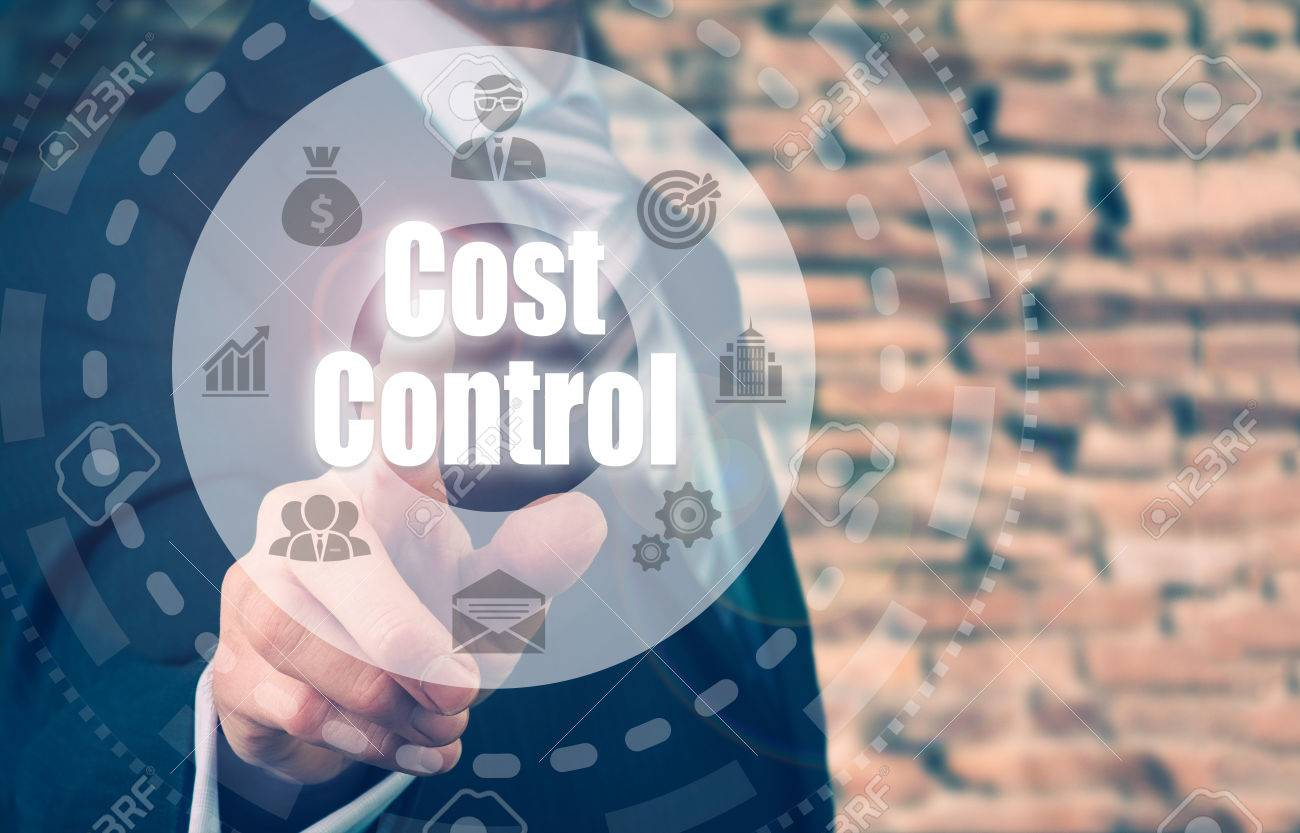 A businessman selecting a Cost Control Concept button on a clear screen. - 61132101