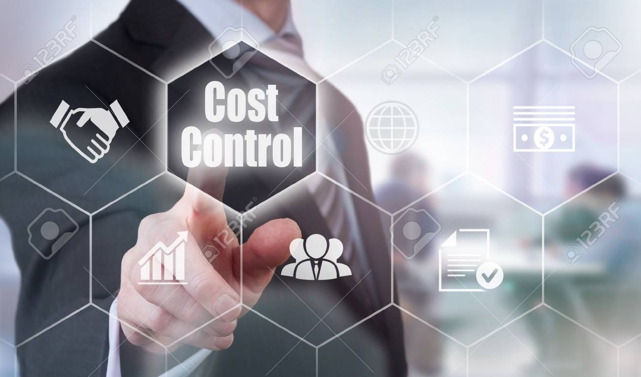 A businessman selecting a Cost Control Concept button on a clear screen. - 61132104