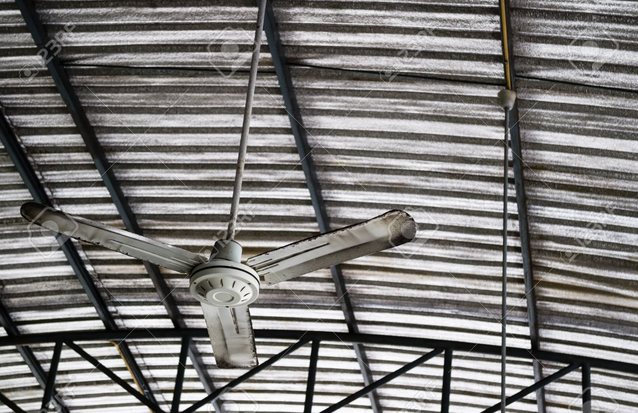 old rusty gray metal ceiling fan hang on warehouse ceiling which rh 123rf com bunnings warehouse ceiling fans lighting warehouse ceiling fans