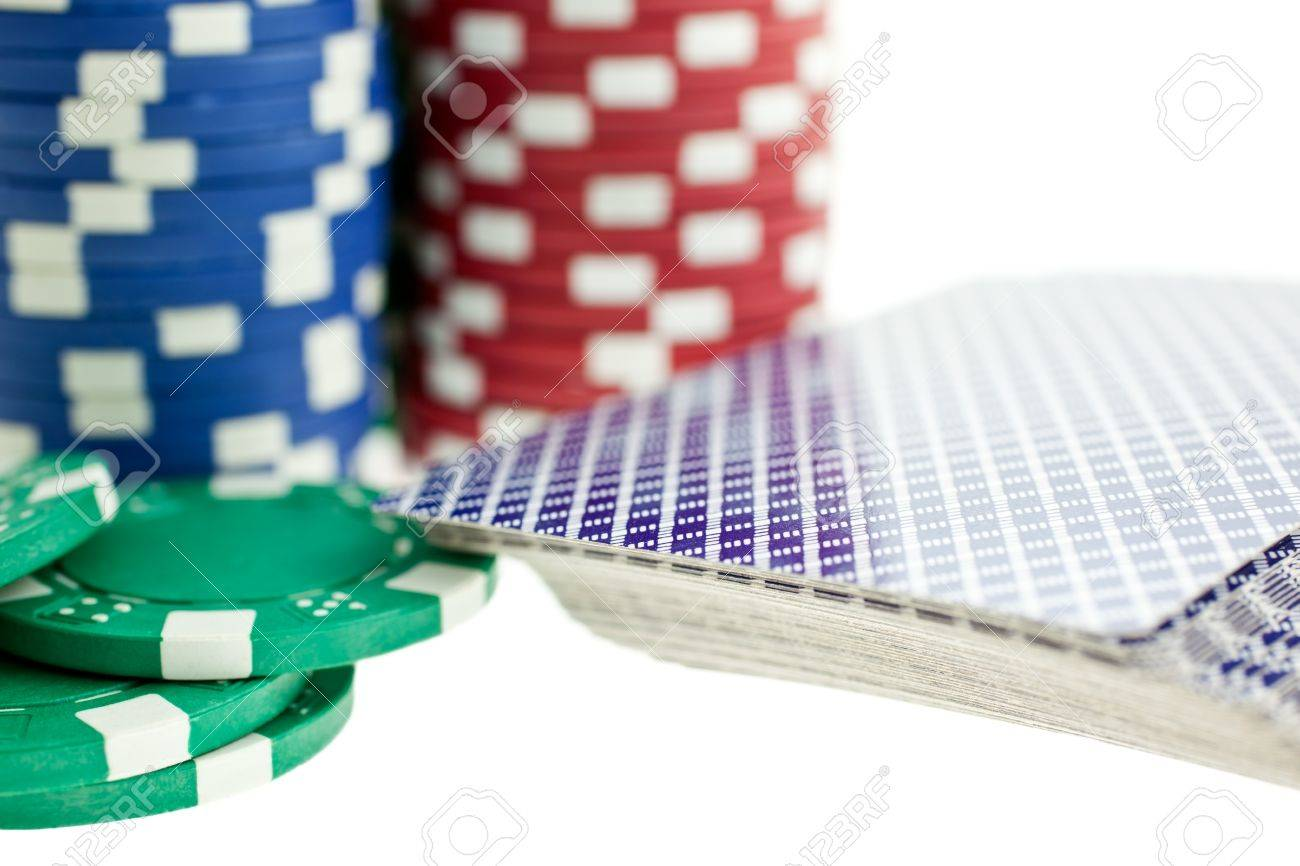 Three color poker chip stacks and cards deck on white background Stock Photo - 7747238