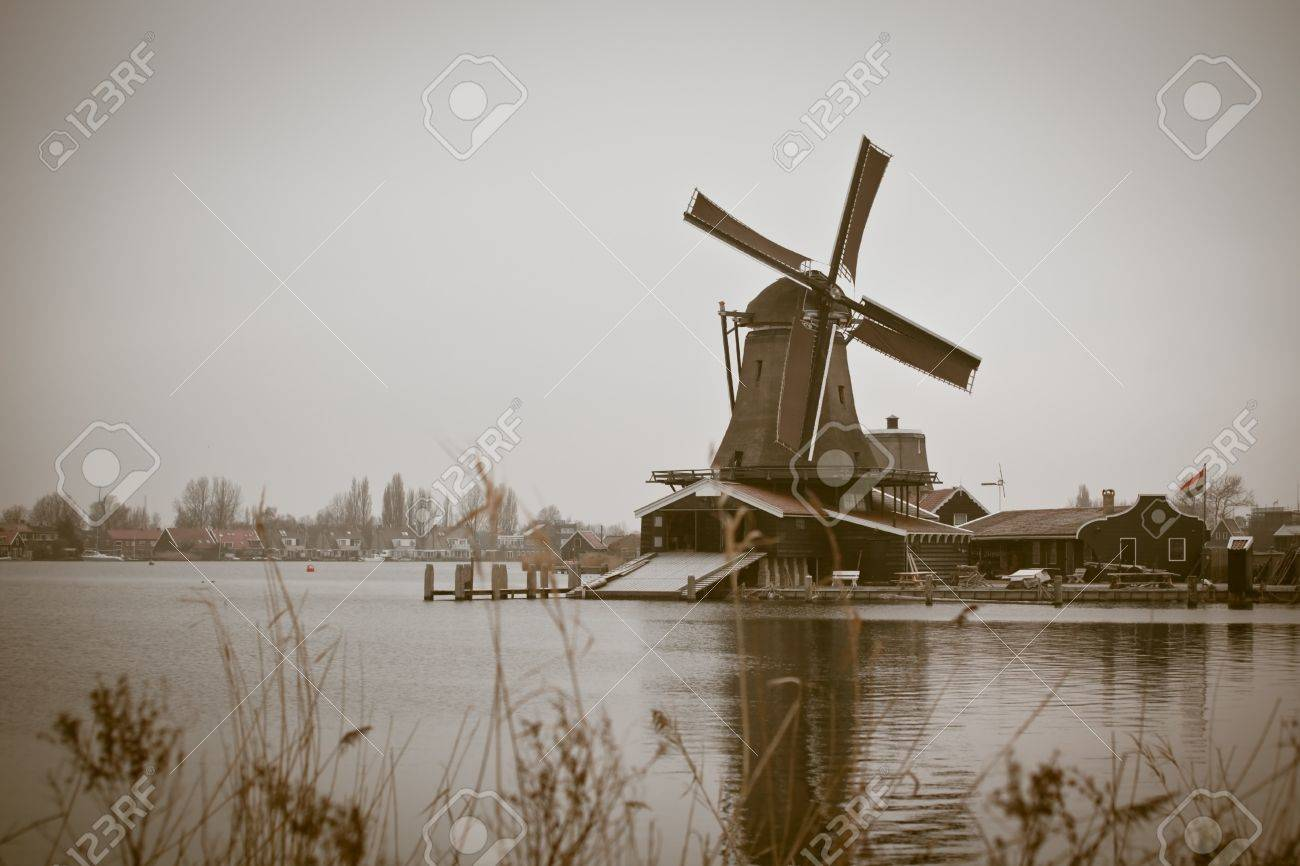 sepia toned image of windmill in winter Zaanse Schans. horizontal shot Stock Photo - 7747307