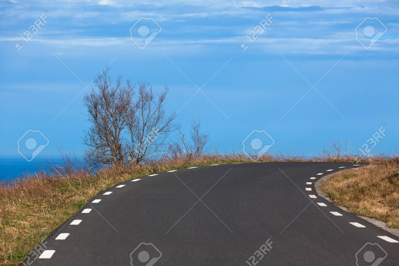Asphalt road turn in rural place at seaside. Horizontal shot Stock Photo - 14417456