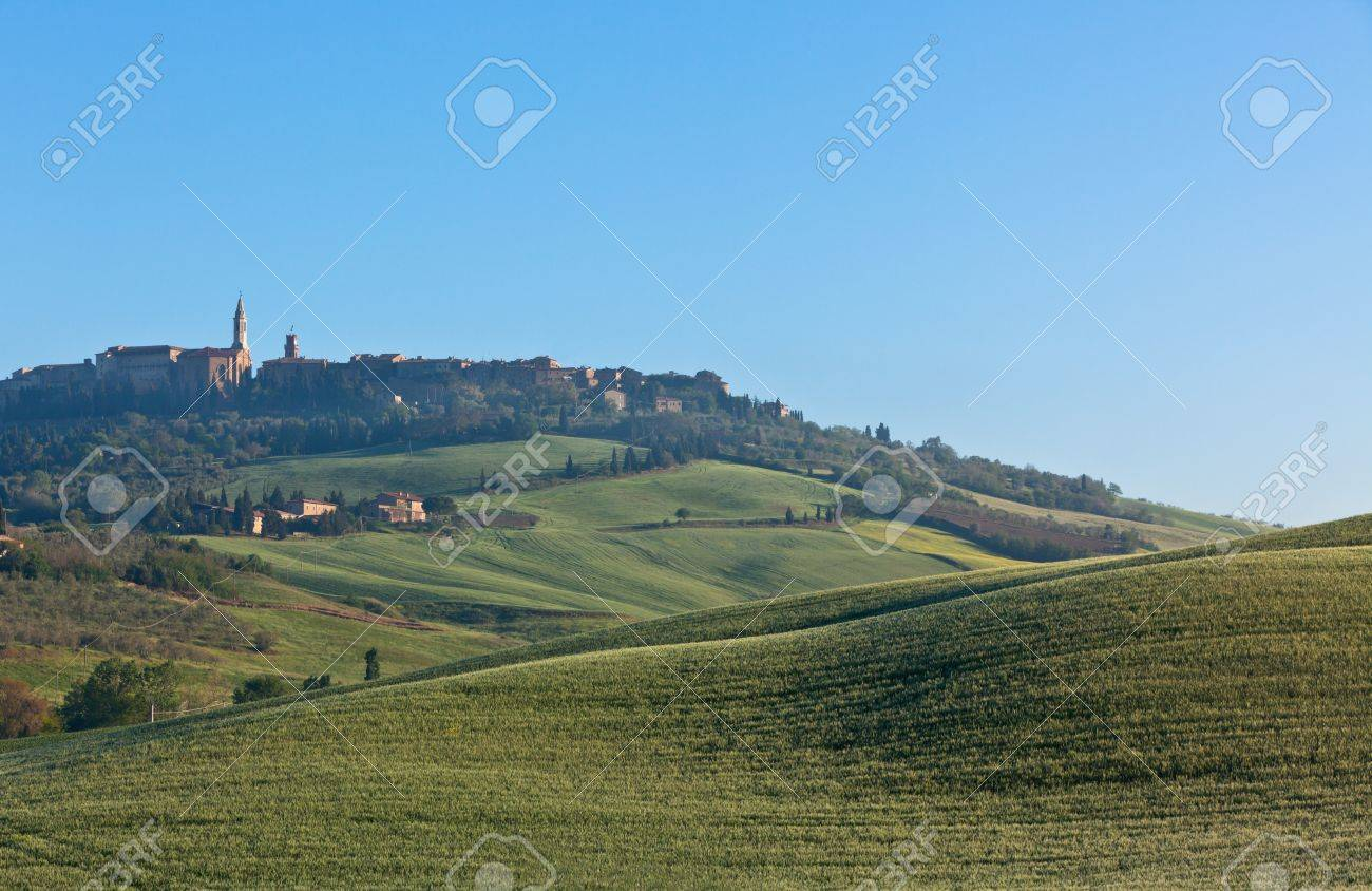 Morning fog view on Pienza town at Valley d?Orcia in Tuscany, Italy. Stock Photo - 14574398