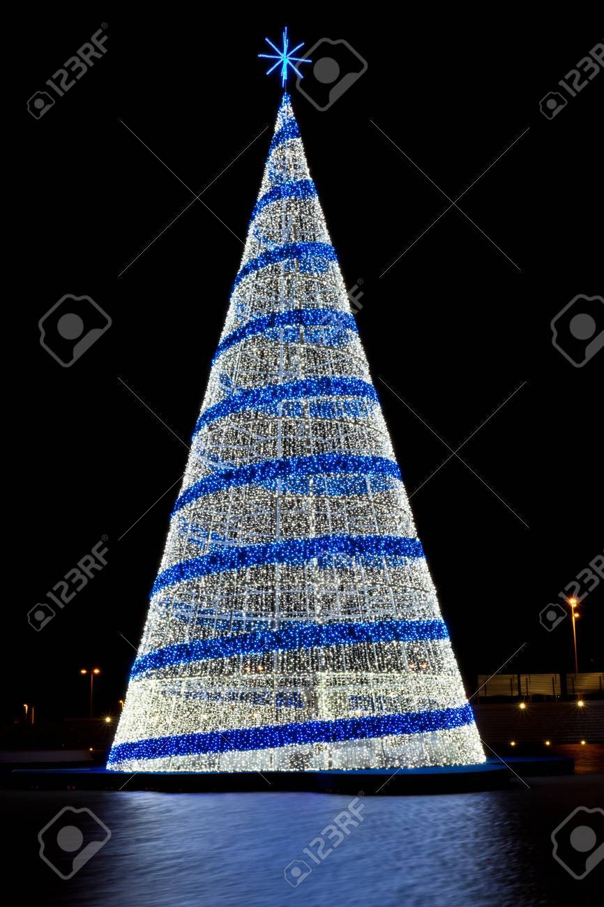 Pine Christmas Tree Figure With Blue And White Lights Against Stock Photo Picture And Royalty Free Image Image 15011777