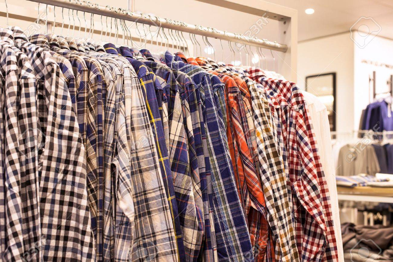 Clothing in Fashion Store - Checkered Men Shirts on the Store Rack Stock Photo - 16928364