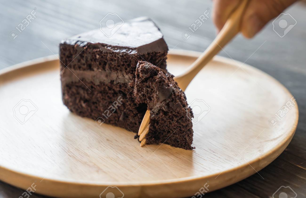 Chocolate Soft Cake On Wood Plate Stock Photo Picture And Royalty