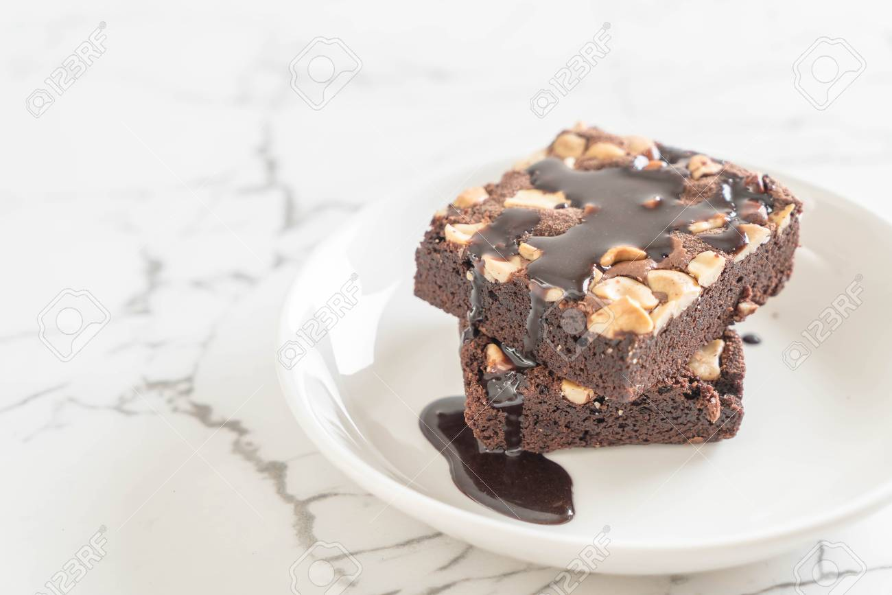 Chocolate Brownies With Chocolate Sauce On The Table Stock Photo