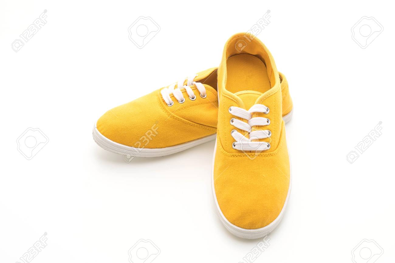 e0a69e07536313 Stock Photo - yellow sneakers isolated on white background