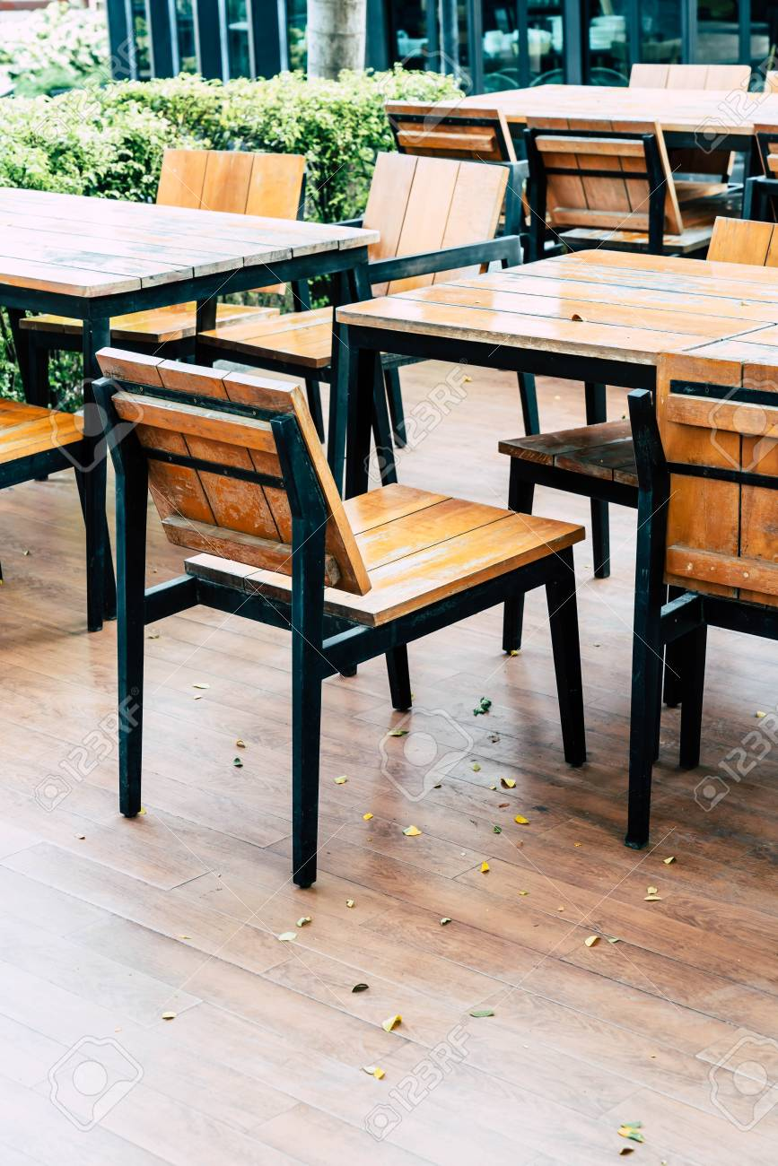 Empty Wood Table And Chair In Outdoor Restaurant Vintage Filter Stock Photo Picture And Royalty Free Image Image 95884421