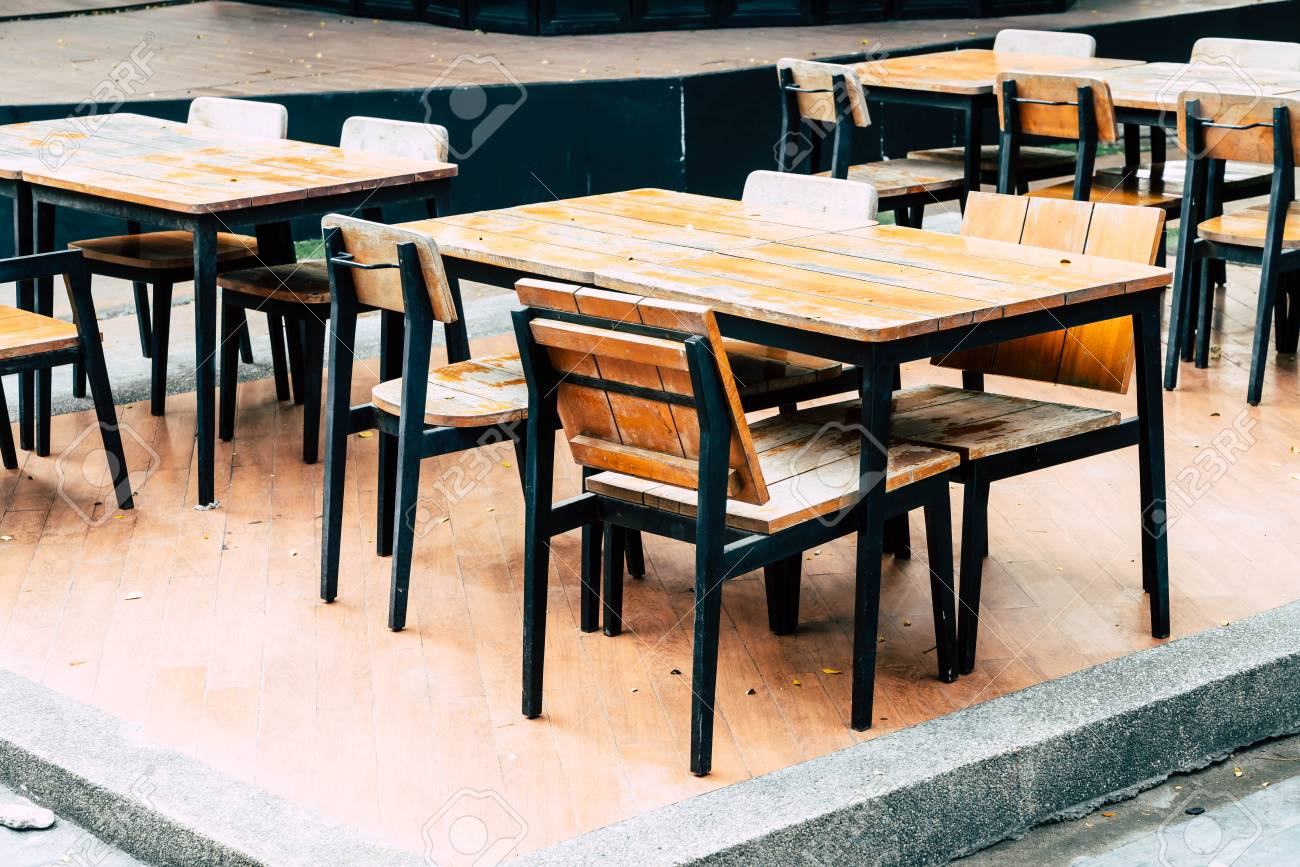 Empty Wood Table And Chair In Outdoor Restaurant Vintage Filter Stock Photo Picture And Royalty Free Image Image 96446833