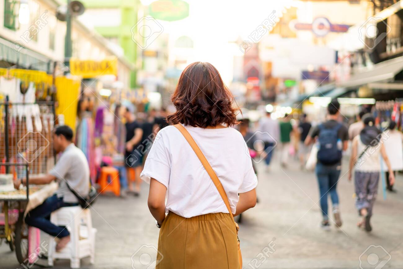 Happy and Beautiful Asian woman traveling at Khao Sarn Road in Thailand - 120438172