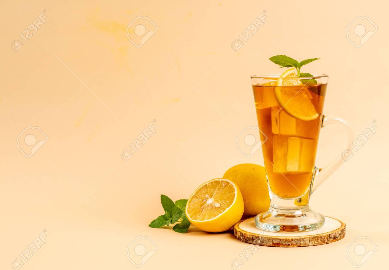 glass of ice lemon tea with mint - 122140404
