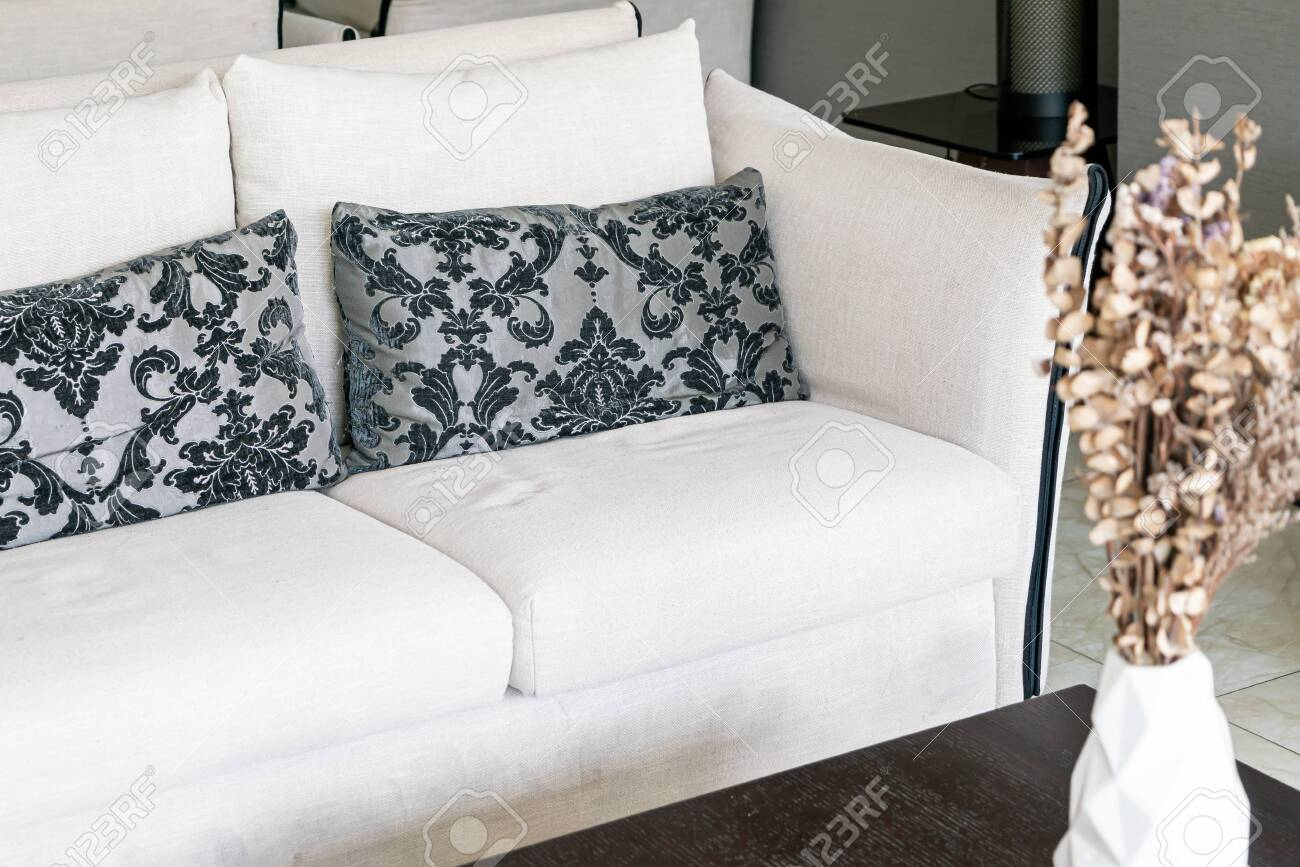 beautiful pillows on sofa decoration in living room interior