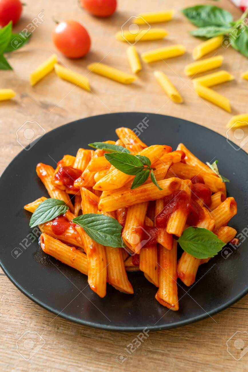 Penne Pasta In Tomato Sauce Italian Food Style Stock Photo Picture And Royalty Free Image Image 137130379