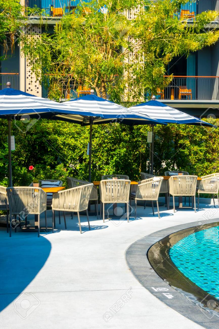 outdoor patio deck and chair around swimming pool - 137376940