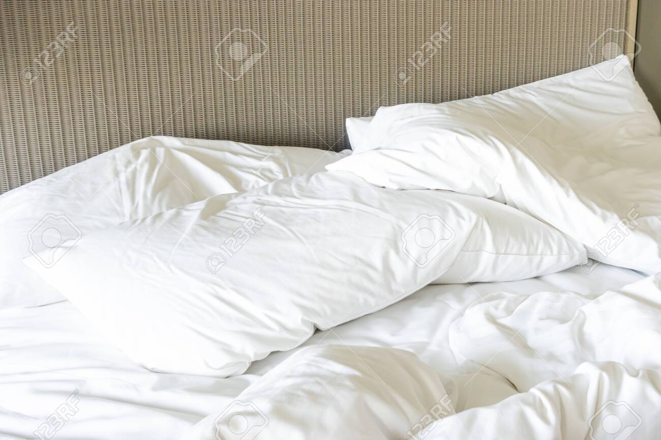 Messy bed, White pillow with blanket on bed unmade - 139647476