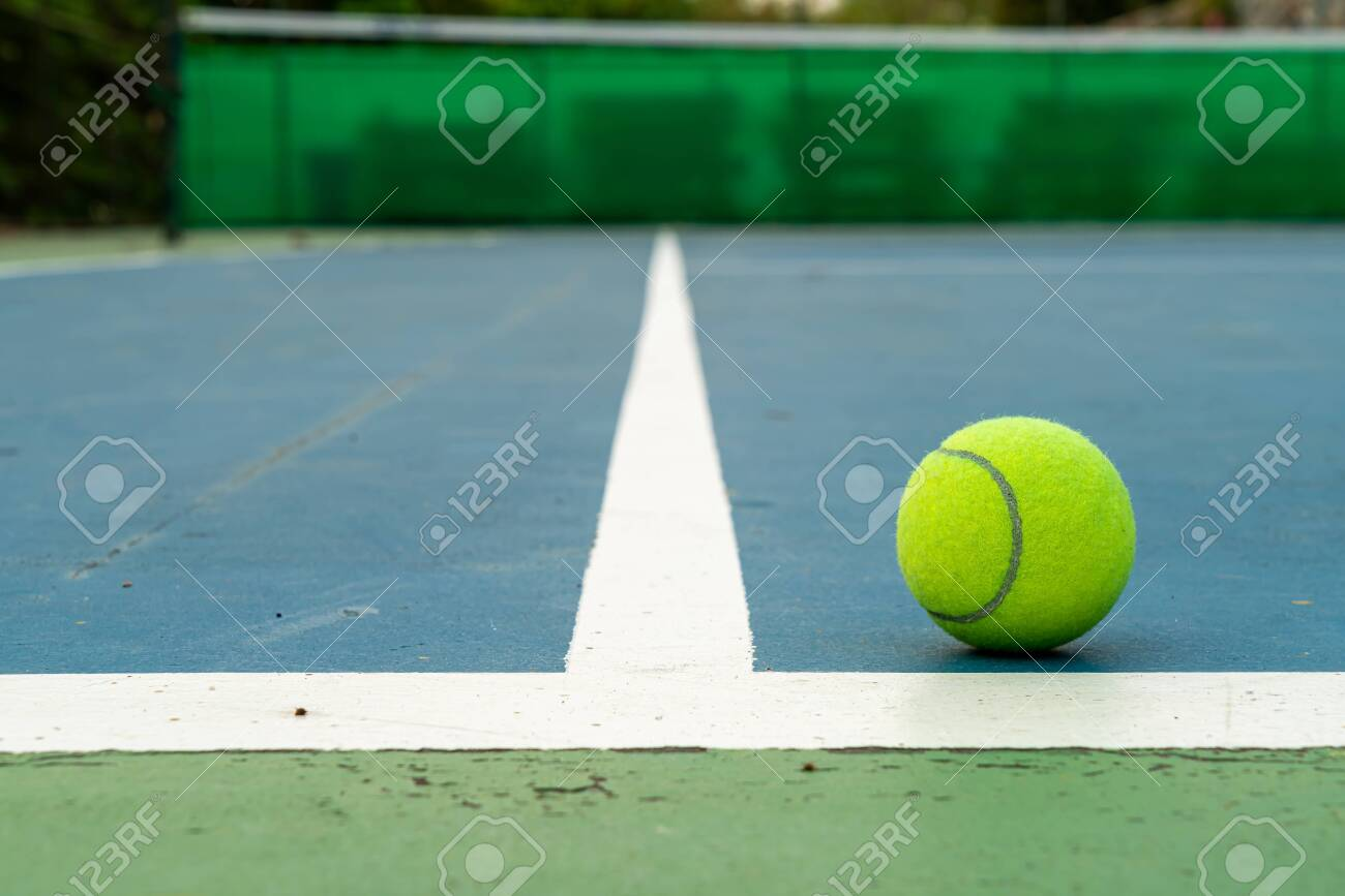 Close Up Tennis Ball On Tennis Court With Copy Space Stock Photo Picture And Royalty Free Image Image 142807286