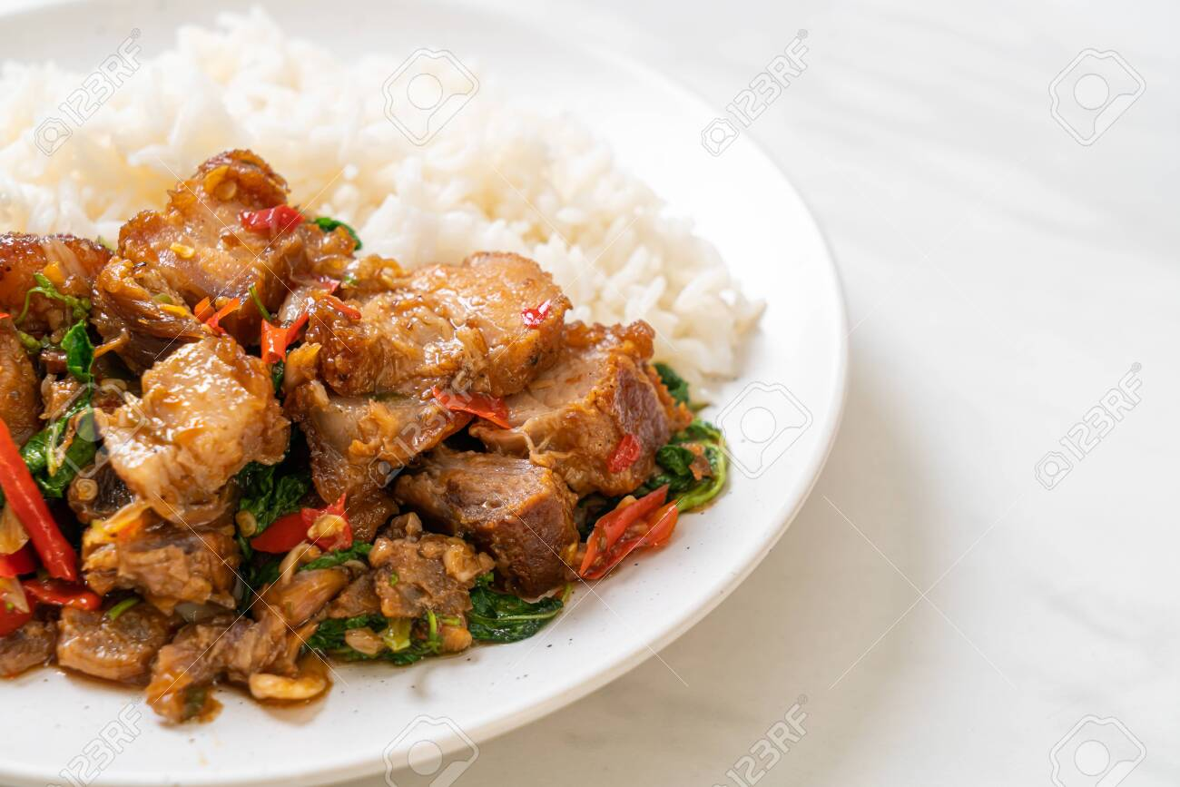 stir-fried crispy pork belly and basil with rice - Asian local street food style - 153877212