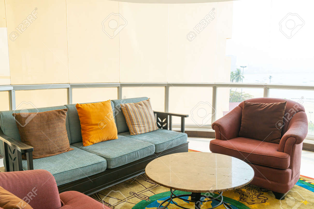empty sofa and chair with pillows decoration in a room - 155293796