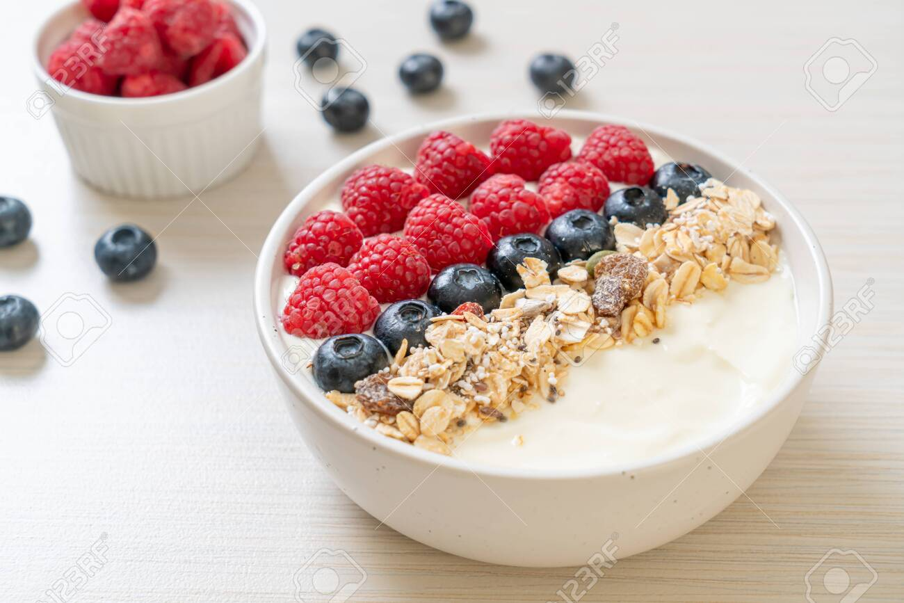 homemade yogurt bowl with raspberry, blueberry and granola - healthy food style - 157348492