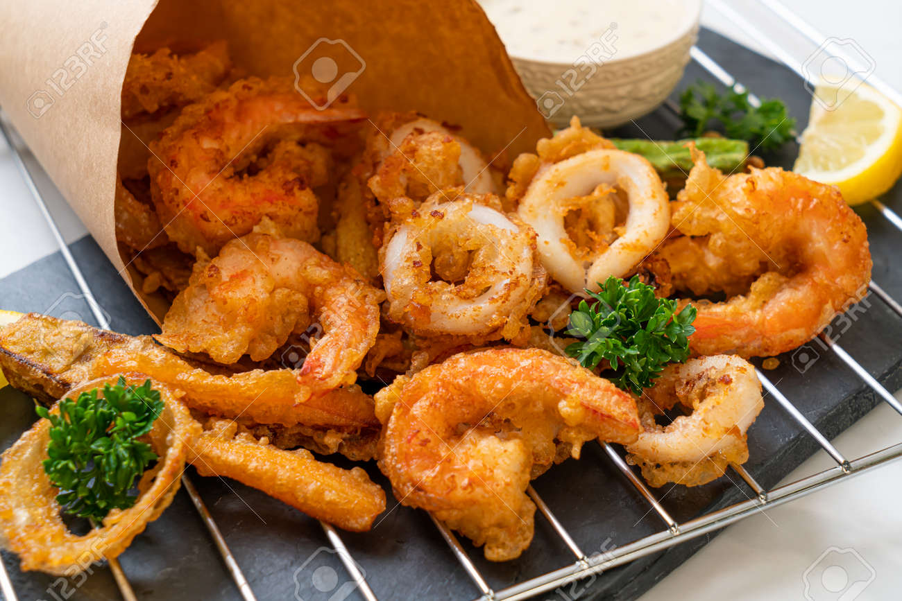 deep fried seafood (shrimps and squid) with mix vegetable - unhealthy food style - 157612880