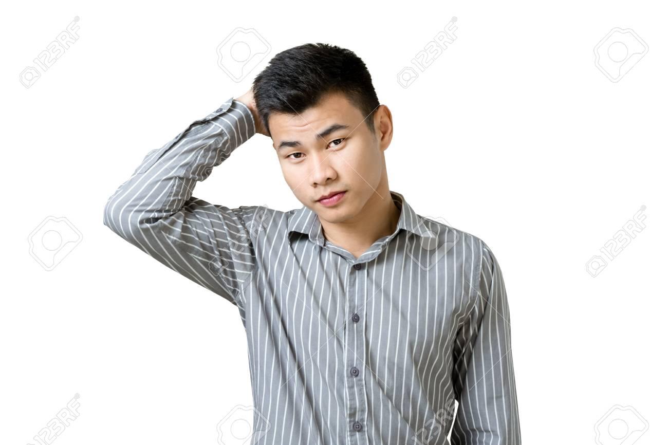 頭をかく混乱して実業家の肖像画 コピー スペースと白い背景で隔離 の写真素材 画像素材 Image